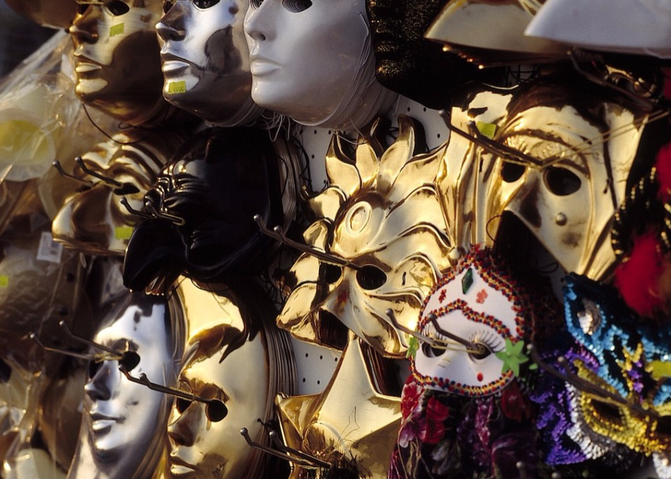 Masks hanging on a stall in Venice