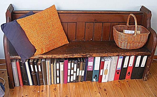 Files in a tidy row beneath a bench seat