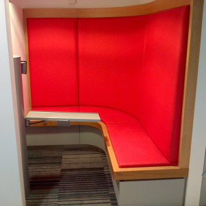 Cubicle with red sofa