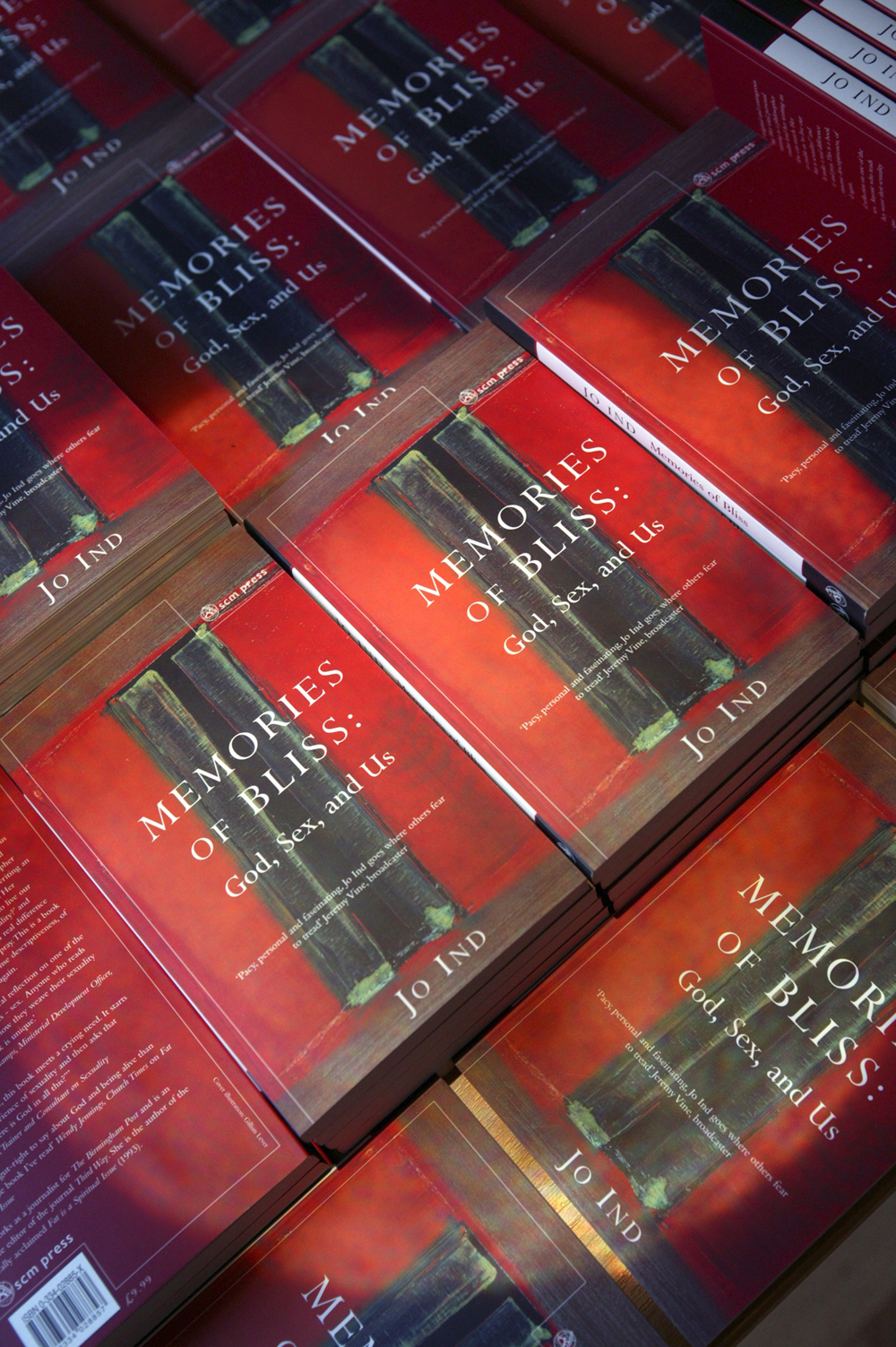 Lots of copies of the book Memories of Bliss on a table
