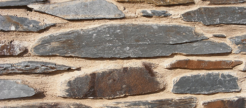 Close up of slate wall at Plas Tagart for Jo Ind's blog post on the launch of Loneliness: Accident or Injustice?