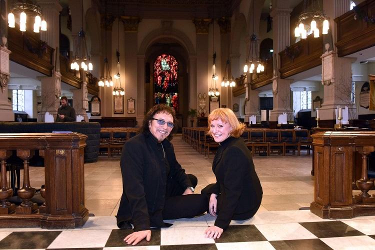 Black Sabbath lead guitarist Tony Iommi sits with Catherine Ogle in Birmingham Cathedral